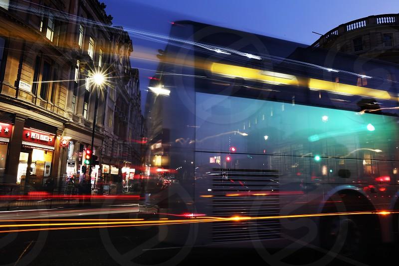 Charring Cross Square; Trafalgar Square; london; uk; england; travel; night; shot; light trails; traffic; cars; bus; movement; moving; traffic photo