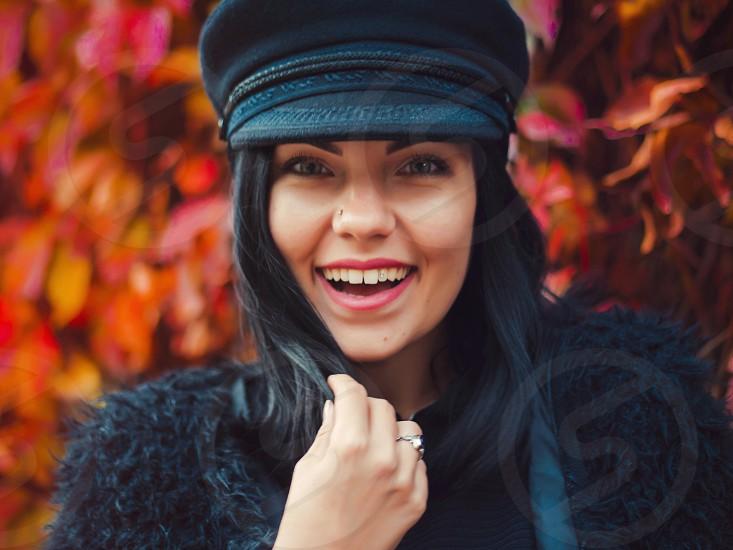 Happy trendy girl in autumn park  photo