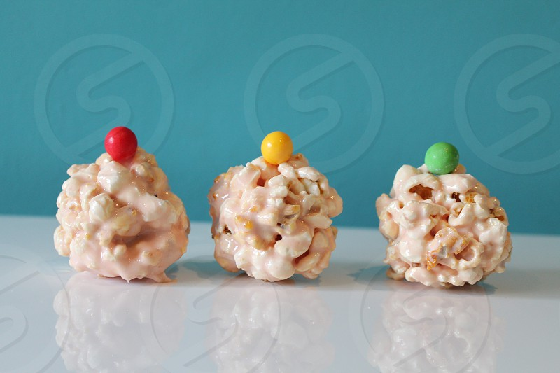 Everyone loves my popcorn balls! Marshmallows and butter melted in the microwave. Add a bag of popcorn and top with a colourful treat! Mmmmmmm photo