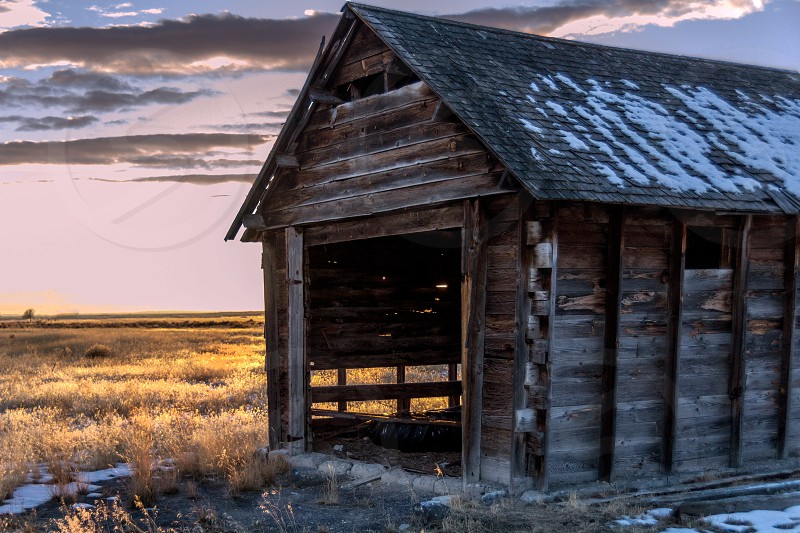 an abandoned shed out in the desert photo