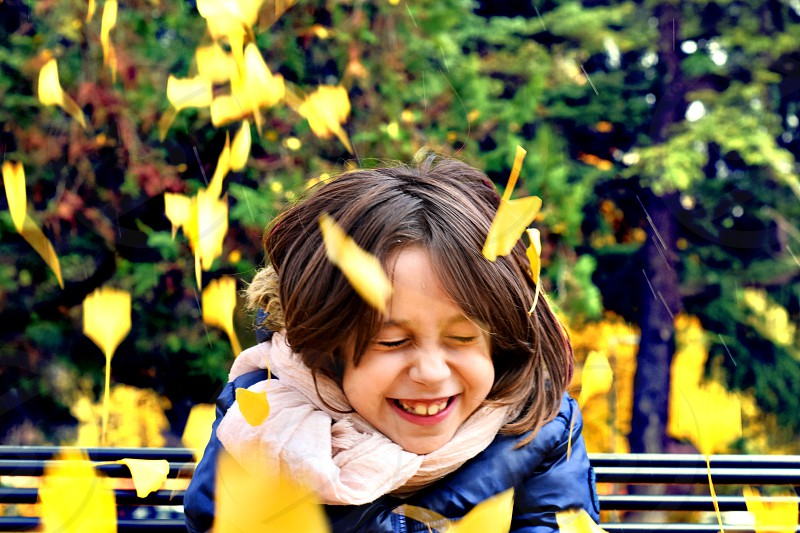 Kids playing in autumn background photo