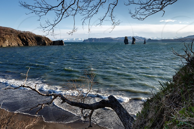 Beautiful Kamchatka Peninsula seascape: view of rocky islands in sea - Three Brothers Rocks in Avacha Bay (Avachinskaya Bay) in Pacific Ocean. Kamchatka Region Russian Far East Eurasia. photo