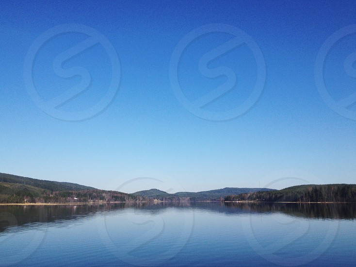 blue sky and body of water photo
