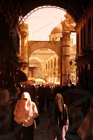 a street in the old town or souq in the city of Damaskus in Syria in the middle east photo