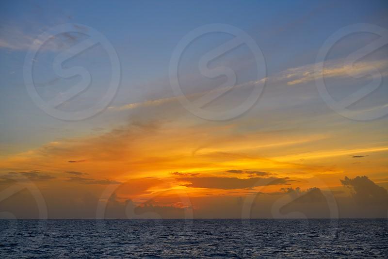 Caribbean sunset on the sea in Riviera Maya photo