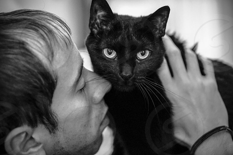 Elegant black; black and white; black cat; cat; man photo