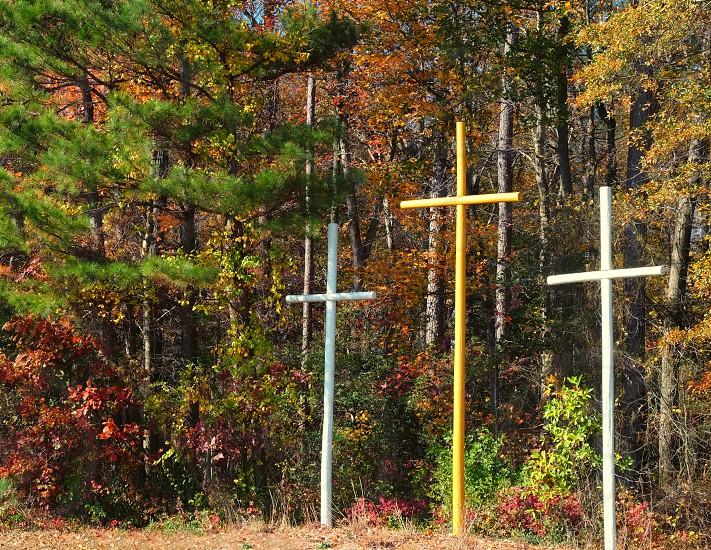 Autumn scene with 3 crosses photo