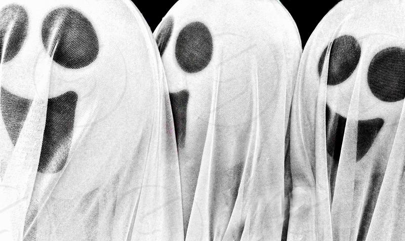 Three white gauzy smiling ghosts for Halloween photo