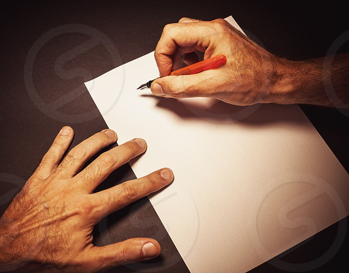 Conceptual composition of somebody writing a letter view from the position of head.  photo