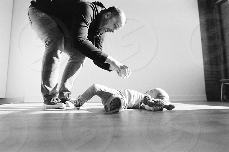 Father and daughter playing together.  photo