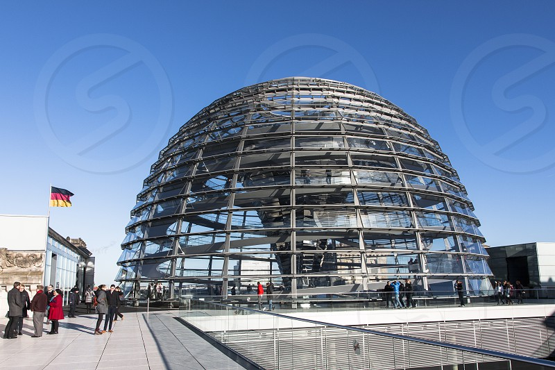 Reichstag building - Berlin seat of the German Parliament with the glass dome which give a panoramic view over Berlin. photo