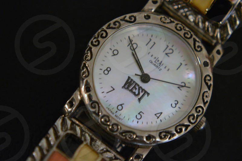 silver west analog watch at 9:50 photo