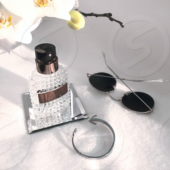 Flatlay fragrance bracelet sunglasses  photo