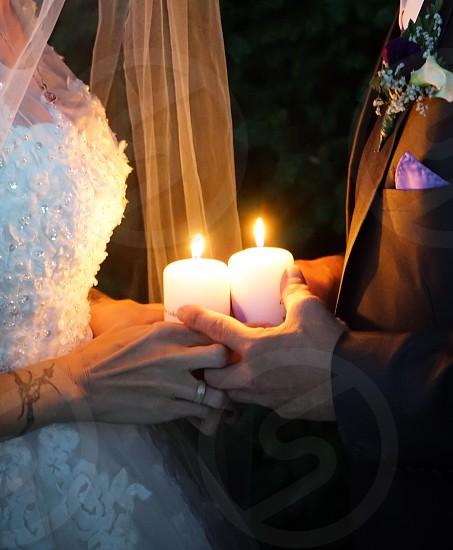 Wedding candle love warm hands nofaces weddingdress  photo