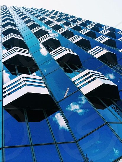blue tinted high rise building photo