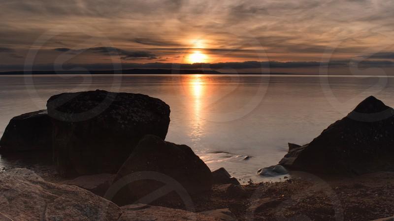 Sunset photo over lake superior using long exposure settings photo
