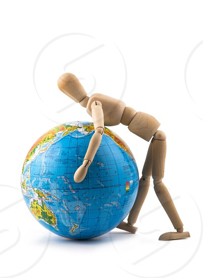 Figurine of a man trying to raise the globe photo