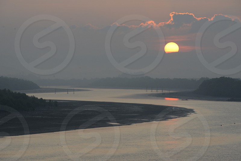 a river by sunrise near the city of Myeik in the south in Myanmar in Southeastasia. photo