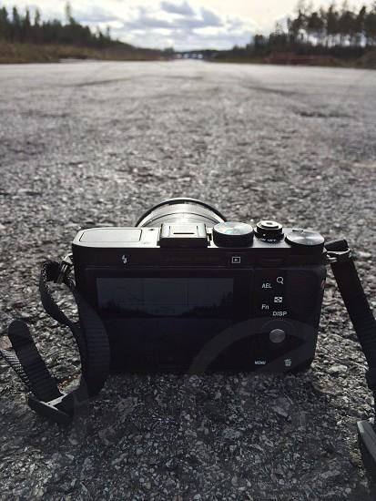 digital camera on concrete pavement macro photography photo