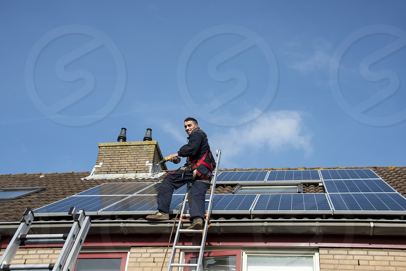 man smiling and happy with construction of solar panels photo