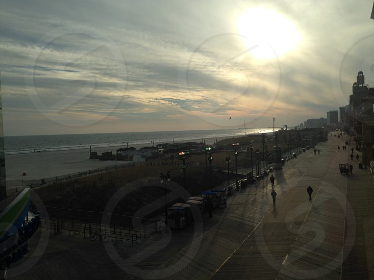 Lens flare from the sunset over the board walk at Atlantic City photo