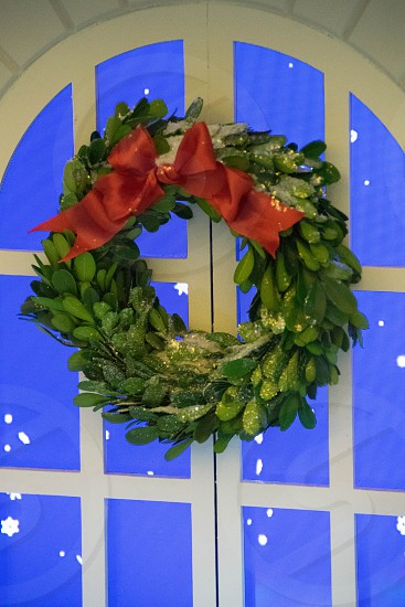 green and red leaf wreath with bow accent photo