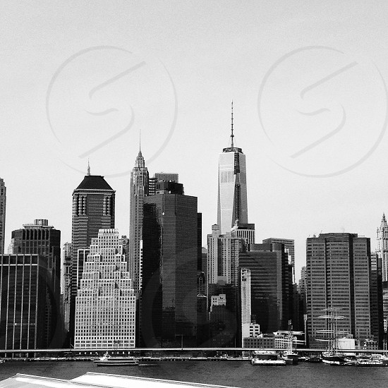high rise building grayscale photography photo