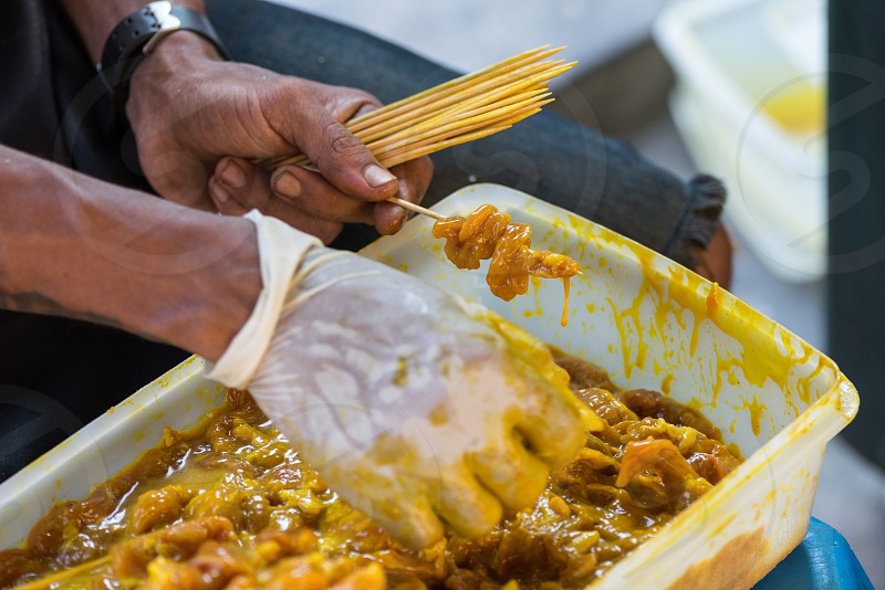 Street food - pork satay preparation photo