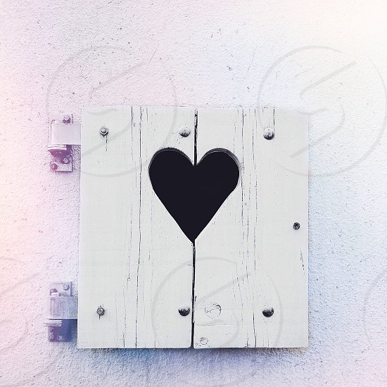 white wooden box with heart hole photo