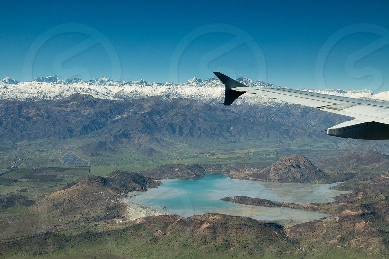 ice cold winter snow andes mountains chile lake airplane plane  photo