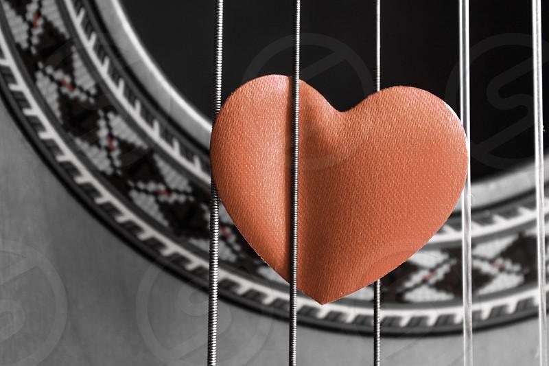 Music guitar strings acoustic pluck fret plectrum  heart love passion photo