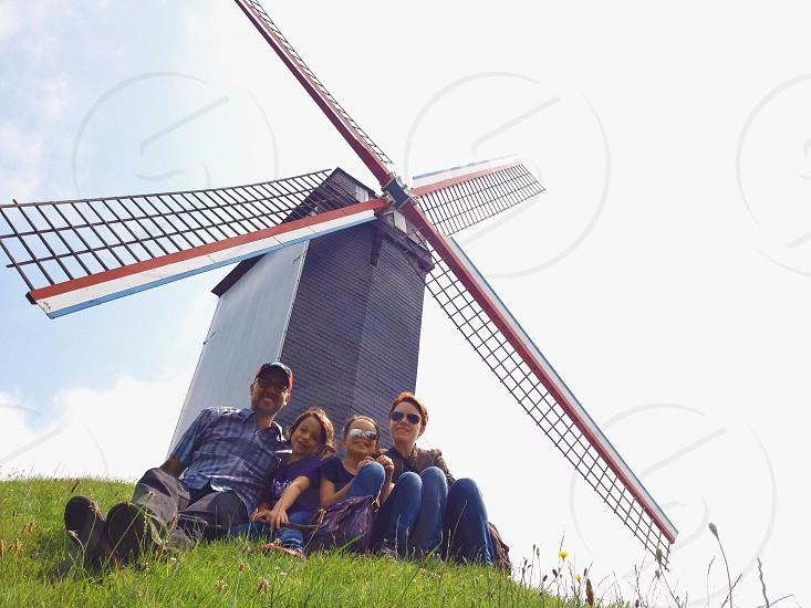 people sitting near windmill photo