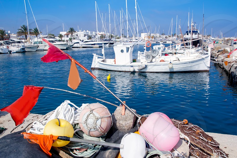 fisherboats with nets longlines buoy tackle in foreground at Formentera photo