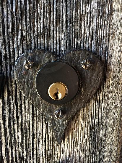black and gold heart shaped keyhole photo