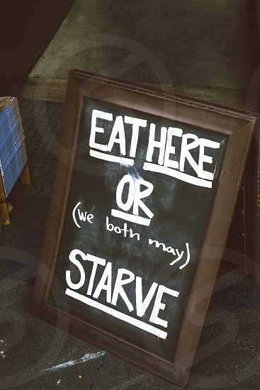 eat here or (we both may) starve menu board signage photo