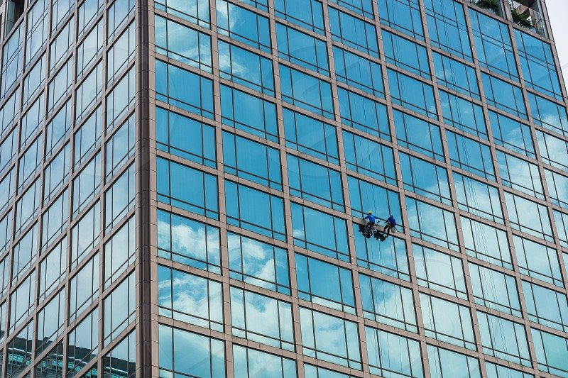 Window cleaners at work in Bangkok Thailand. photo