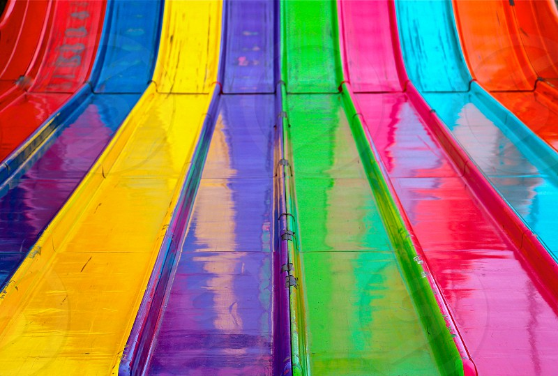 orange teal pink green purple yellow and red slides photo