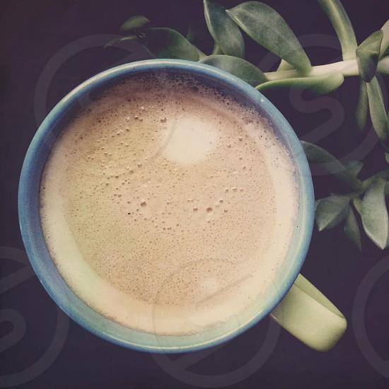 blue ceramic mug with coffee photo