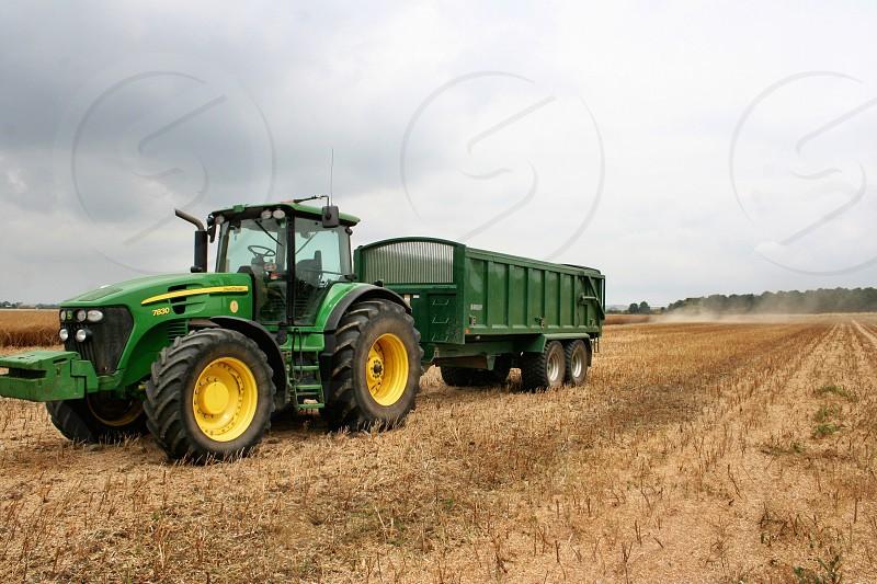 green and yellow john deere tractor photo