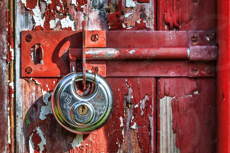 Shiny New Padlock on an Old Door photo