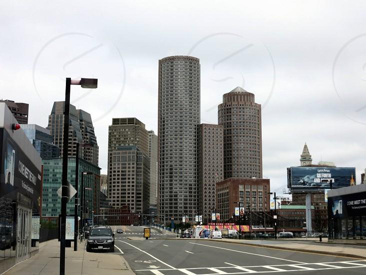 city sky scrapers under cloudy sky photo