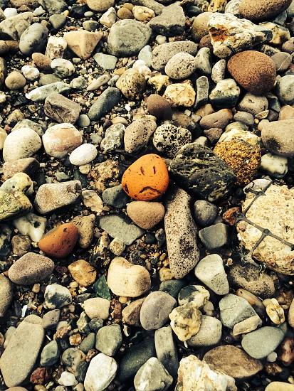 Sad face stone photo