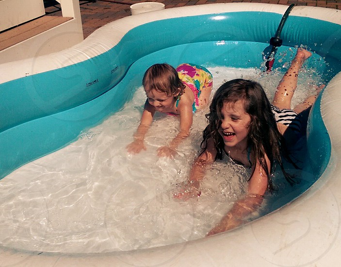 Summer splash pool fun children action photo