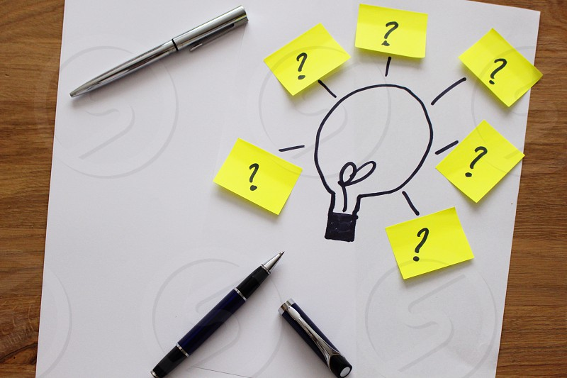 light bulb illustration with yellow sticky notes with question mark print photo