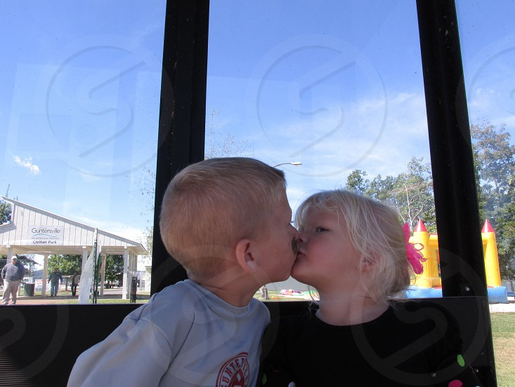 boy and girl kissing photo