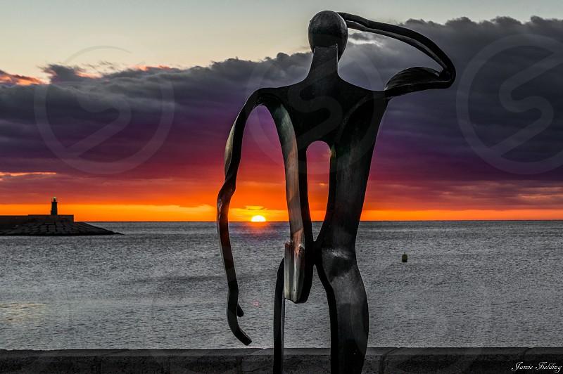 Lightroom sunrise statue man sea calm light colour beautiful metal seaside seascape  photo
