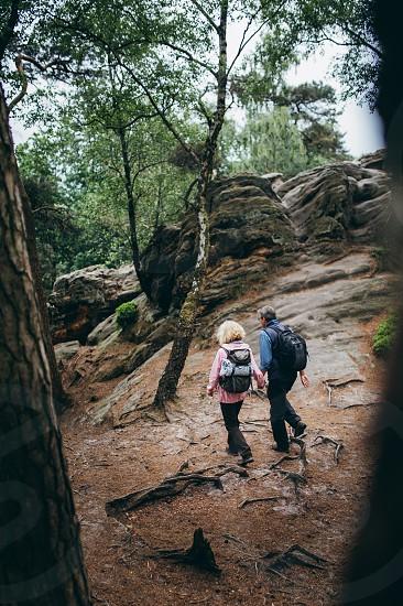 Senior Couple hiking trough forest on Holiday  photo