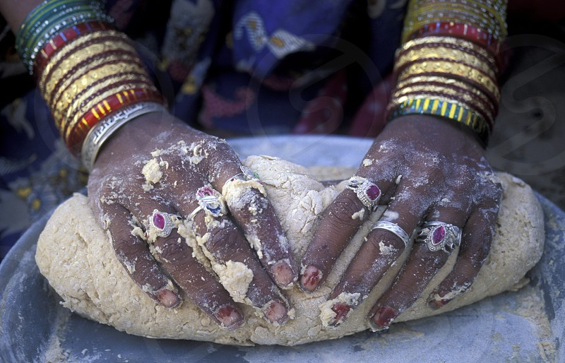 a women is making Bread in the town of Jaisalmer in the province of Rajasthan in India. photo