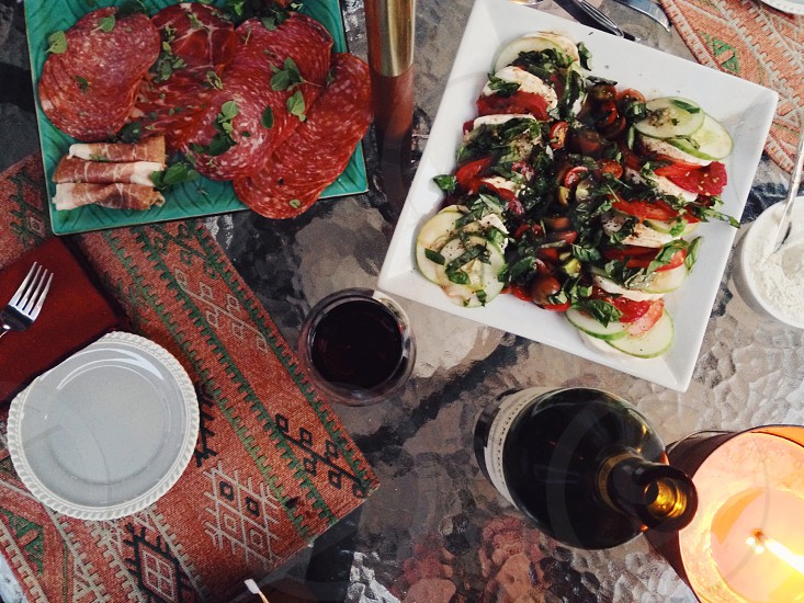 summer outdoor kitchen caprese mozzarella heirloom tomato tomatoes homegrown fresh meat salami capicola wine outdoor dining dinner party appetizer antipasti meal citronella photo