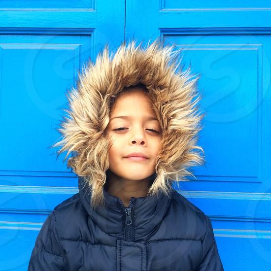 boy in navy blue parka coat photo